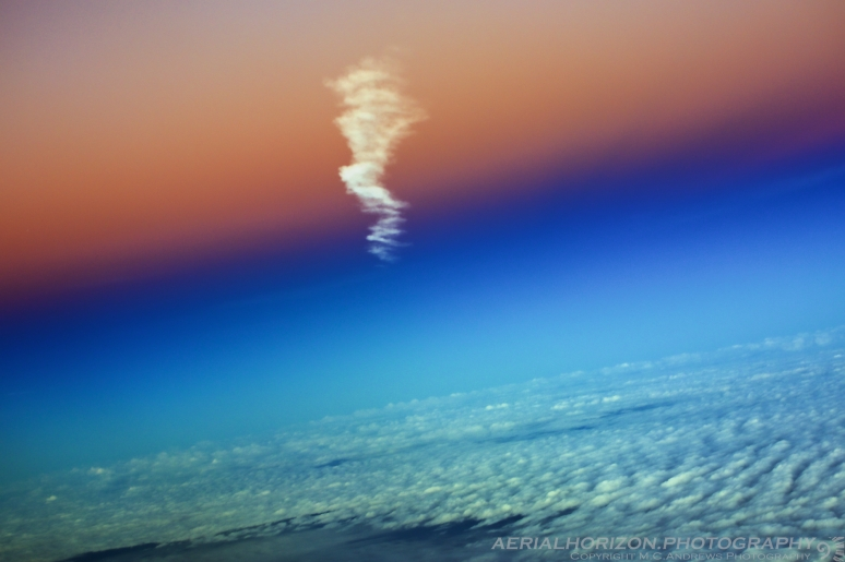 Contrail floating into daylight