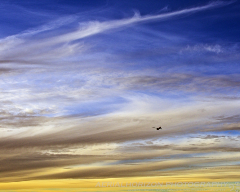 777 descending out of a painted sky